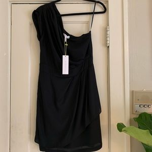 One shoulder black. Never worn BCBG cocktail dress